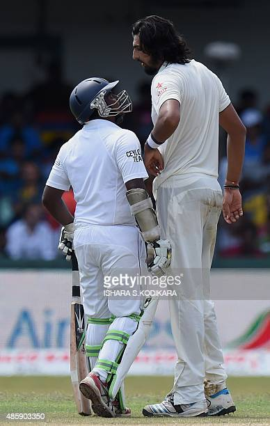 Sri Lankan cricketer Rangana Herath and Indian cricketer Ishant Sharma exchange words during the third day of their third and final Test cricket...