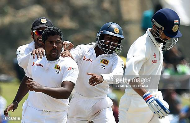 Sri Lankan cricketer Rangana Herath and teammates celebrate after dismissing Indian batsman Ajinkya Rahane during the fourth day of the opening Test...