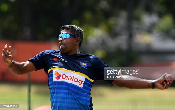 Sri Lankan cricketer Rangana Herath delivers a ball during a practice session at the Sinhalease Sports Club Ground in Colombo on August 2 2017 The...