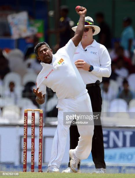 Sri Lankan cricketer Rangana Herath delivers a ball during the second day of the second Test match between Sri Lanka and India at the Sinhalese...