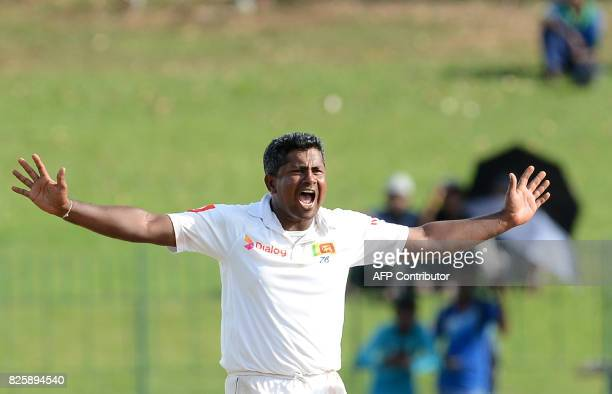 Sri Lankan cricketer Rangana Herath unsuccessfully appeals for a Leg Before Wicket decision against Indian cricketer Ajinkya Rahane during the first...