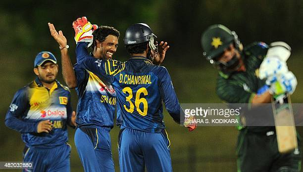 Sri Lankan cricketer Sachithra Senanayake and teammates celebrate after dismissing Pakistan cricketer Yasir Shah during the fifth and final one day...