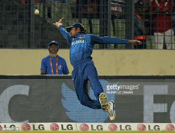 Sri Lankan cricketer Sachithra Senanayake tries to catch a ball during the ICC World Twenty20 cricket tournament final match between India and Sri...