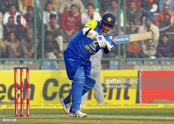 Sri Lankan cricketer Sanath Jayasuriya plays a stroke during the fifth and final One Day International cricket match between India and Sri Lanka at...