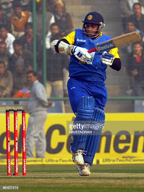 Sri Lankan cricketer Sanath Jayasuriya plays a stroke to the boundary during the fifth and final One Day International cricket match between India...