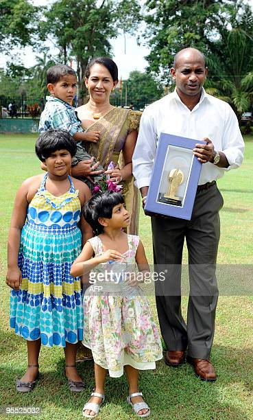 Sri Lankan cricketer Sanath Jayasuriya poses with his wife Sandra son Ranuk and daughters Yeheli and Kashini after presented a trophy by President...