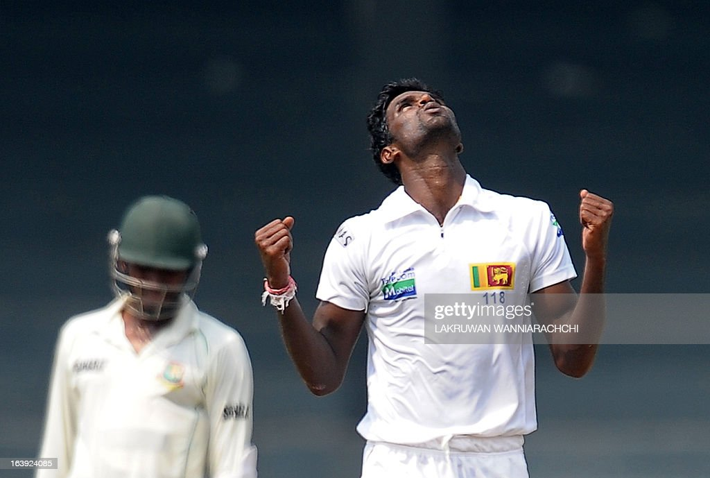 Sri Lankan cricketer Shaminda Eranga (R) celebrates after dismissing unseen Bangladeshi cricketer Tamim Iqbal during the third day of the second Test match between Sri Lanka and Bangladesh at the R. Premadasa Cricket Stadium in Colombo on March 18, 2013.
