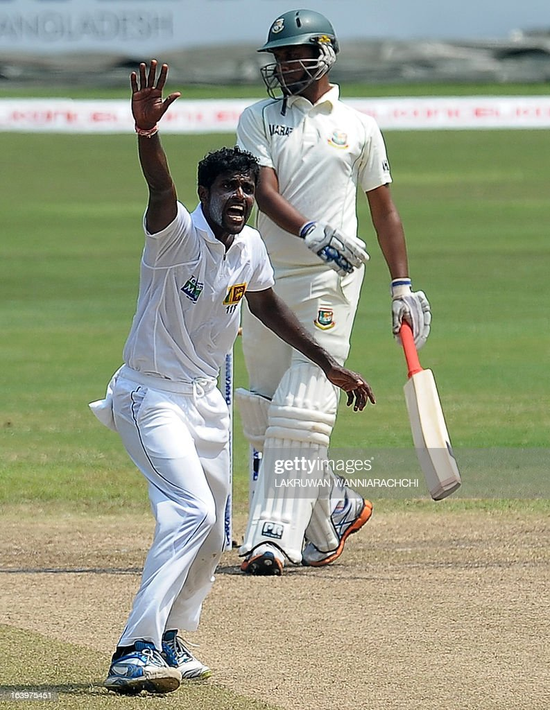 Sri Lankan cricketer Shaminda Eranga (L) makes an unsuccessful appeal for a Leg Before Wicket (LBW) decision against Bangladeshi captain Mushfiqur Rahim during the fourth day of the second Test match between Sri Lanka and Bangladesh at the R. Premadasa Cricket Stadium in Colombo on March 19, 2013. AFP PHOTO/ LAKRUWAN WANNIARACHCHI