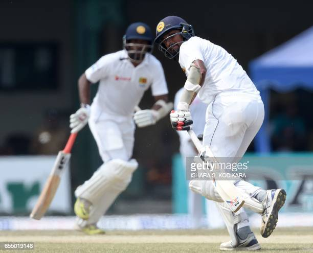 Sri Lankan cricketer Suranga Lakmal and Dilruwan Perera run between the wickets during the fifth and final day of the second and final Test cricket...