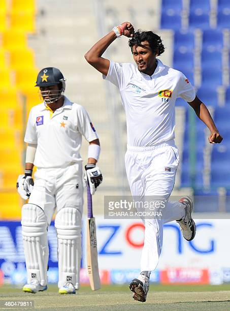 Sri Lankan cricketer Suranga Lakmal celebrates after he dismissed unseen Pakistan batsman Khurram Manzoor during the final day of the first cricket...