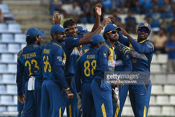 Sri Lankan cricketer Suranga Lakmal celebrates the wicket of West Indies cricketer Darren Bravo with teammates during the third and final One Day...