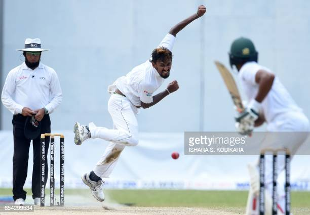 TOPSHOT Sri Lankan cricketer Suranga Lakmal delivers a ball during the third day of the second and final Test match between Sri Lanka and Bangladesh...