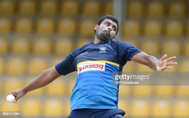Sri Lankan cricketer Thisara Perera delivers the ball during a practice session at the Rangiri Dambulla International Cricket Stadium in Dambulla on...