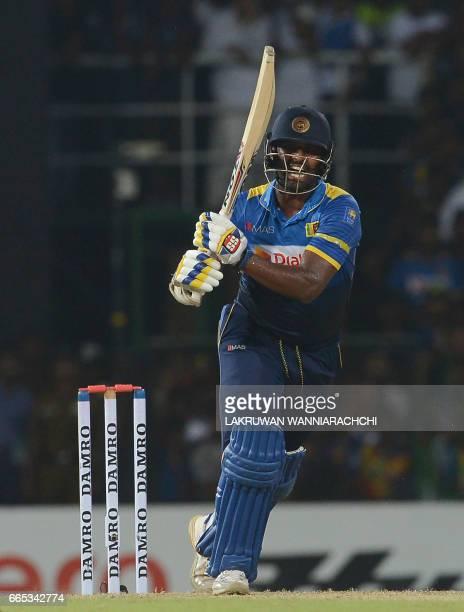 Sri Lankan cricketer Thisara Perera plays a shot during the second T20 international cricket match between Sri Lanka and Bangladesh at the R...