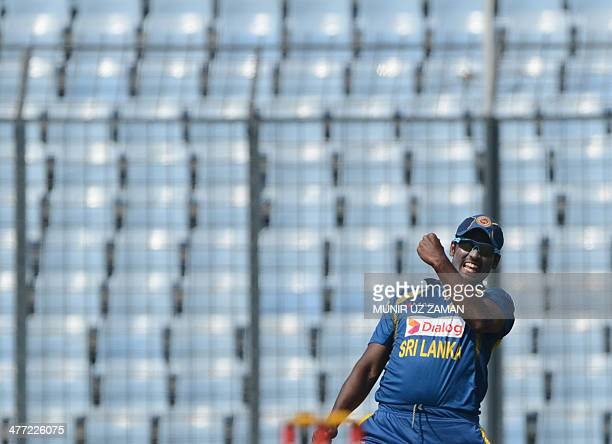 Sri Lankan cricketer Thisara Perera reacts after the dismissal of Pakistan cricketer Sharjeel Khan during the final match of the Asia Cup oneday...