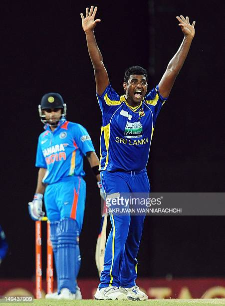 Sri Lankan cricketer Thisara Perera unsuccessfully appeals against Indian cricketer Virat Kohli during the third one day international match between...