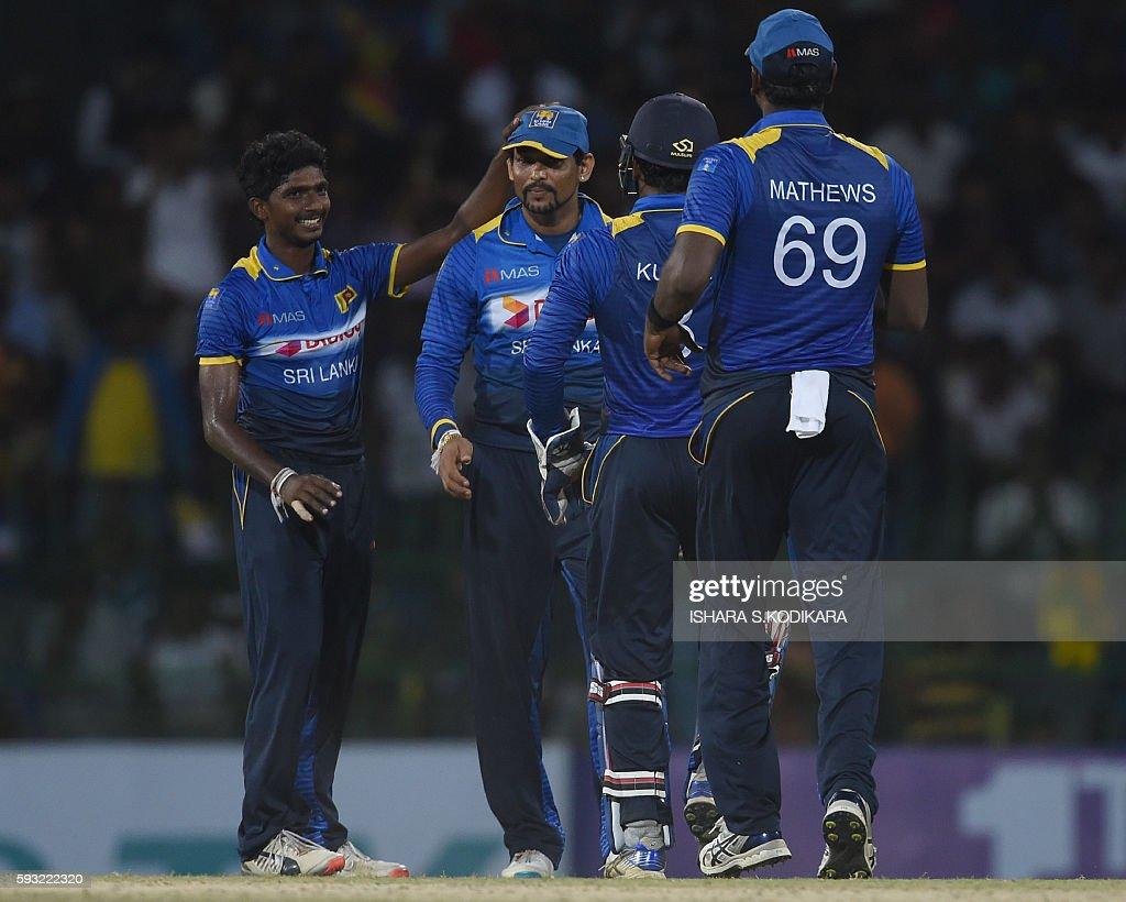 Sri Lankan cricketer Tillakaratne Dilshan Lakshan Sandakan celebrates with his teammates after he dismissed Australian cricketer Matthew Wade during...