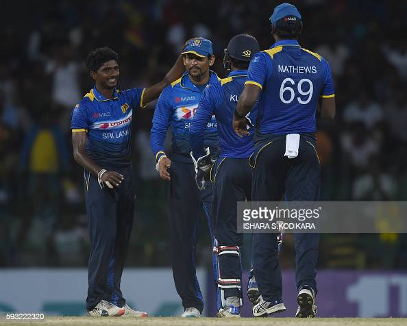 Sri Lankan cricketer Tillakaratne Dilshan Lakshan Sandakan celebrates with his teammates after he dismissed Australian cricketer Matthew Wade during...