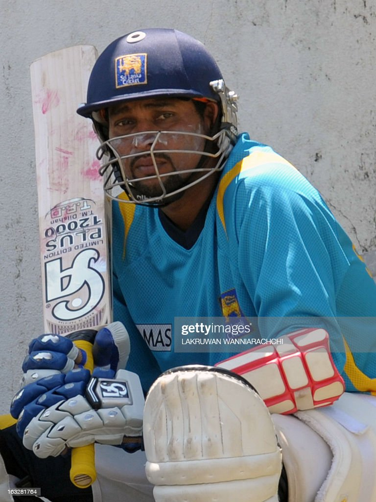 Sri Lankan cricketer Tillakaratne Dilshan looks on during a practice session at the Galle International Cricket Stadium in Galle on March 7, 2013. Sri Lanka will play two Tests, three one-dayers and one Twenty20 cricket matches against Bangladesh, with the first Test to start March 8 in Galle. AFP PHOTO/ LAKRUWAN WANNIARACHCHI