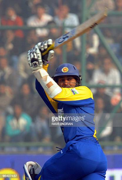 Sri Lankan cricketer Tillakaratne Dilshan plays a stroke during the fifth and final One Day International cricket match between India and Sri Lanka...