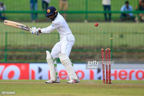 Sri Lankan cricketer Upul Tharanga gets bowled out during the 2nd Day's play in the 3rd Test match between Sri Lanka and India at the Pallekele...