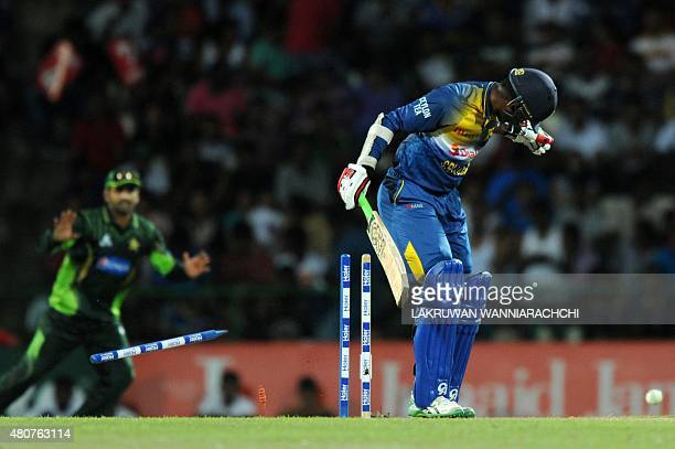Sri Lankan cricketer Upul Tharanga is dismissed by Pakistan crickete Rahat Ali during the second One Day International match between Sri Lanka and...