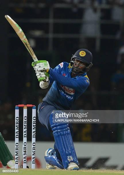 Sri Lankan cricketer Upul Tharanga plays a shot during the second T20 international cricket match between Sri Lanka and Bangladesh at the R Premadasa...