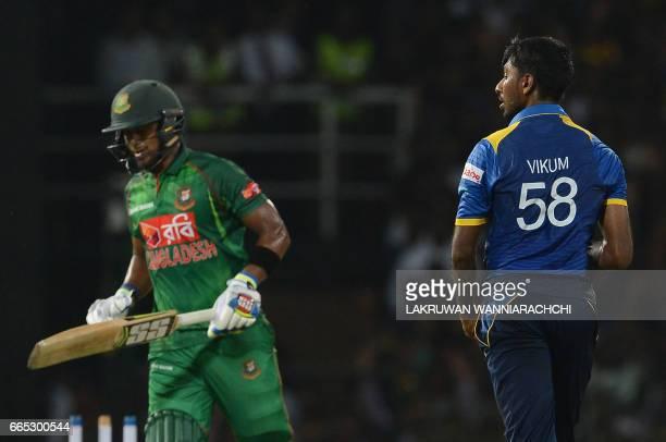 Sri Lankan cricketer Vikum Sanjaya celebrates after he dismissed Bangladesh cricketer Sabbir Rahman during the second T20 international cricket match...