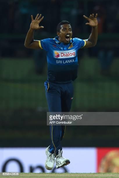 Sri Lankan cricketer Vishwa Fernando appeals unsuccessfully for the wicket of Indian batsman Shikar Dhawan during the third one day international...