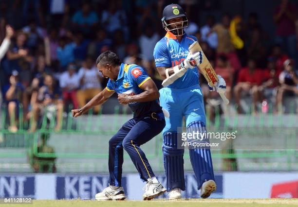 Sri Lankan cricketer Vishwa Fernando celebrates after he dismissed Indian cricketer Shikhar Dhawan during the fourth one day international cricket...