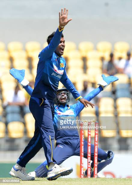 Sri Lankan cricketer Wanidu Hasaranga celebrates after he dismissed Zimbabwe cricketer Craig Ervine during the third oneday international cricket...