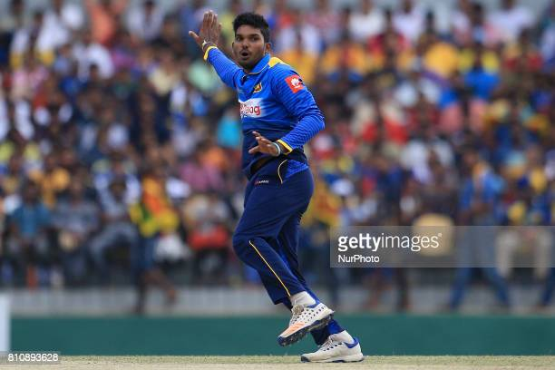 Sri Lankan cricketer Wanidu Hasaranga celebrates after taking the wicket of Zimbabwe's Hamilton Masakadza during the 4th One Day International...