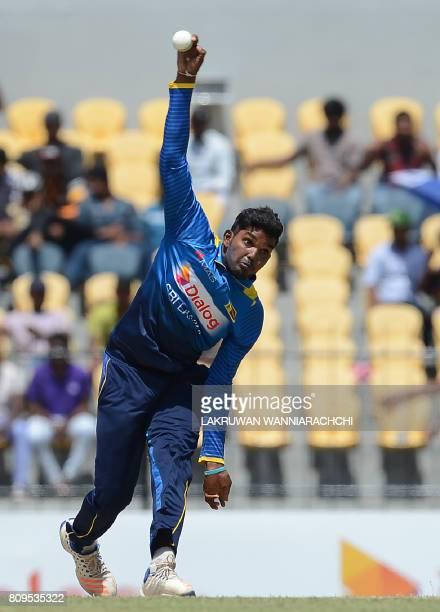 Sri Lankan cricketer Wanidu Hasaranga delivers a ball during the third oneday international cricket match between Sri Lanka and Zimbabwe at the...