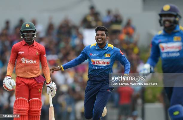 Sri Lankan cricketer Wanindu Hasaranga celebrates after he dismissed Zimbabwe's cricketer Solomon Mire during the fourth oneday international cricket...