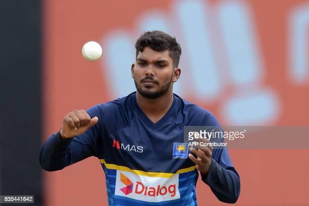 Sri Lankan cricketer Wanindu Hasaranga tosses a ball during a practice session at the Rangiri Dambulla International Cricket Stadium in Dambulla on...