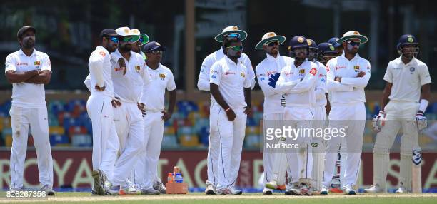 Sri Lankan cricketers and Indian cricketer Hardik Pandya look on during the 2nd Day's play in the 2nd Test match between Sri Lanka and India at the...