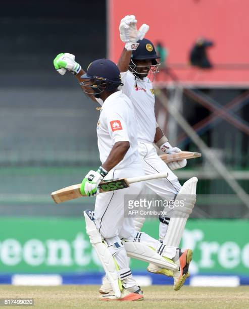 Sri Lankan cricketers Asela Gunaratne and Dilruwan Perera celebrate their team's victory over Zimbabwe by 4 wickets on the final day of a oneoff Test...