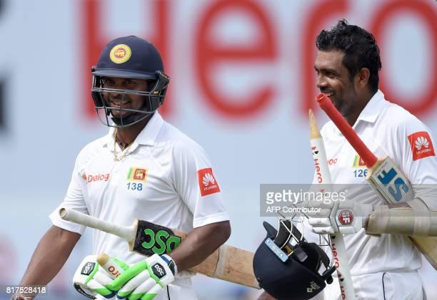 Sri Lankan cricketers Asela Gunaratne and Dilruwan Perera walk off the pitch as they celebrate winning over Zimbabwe on the final day of a oneoff...