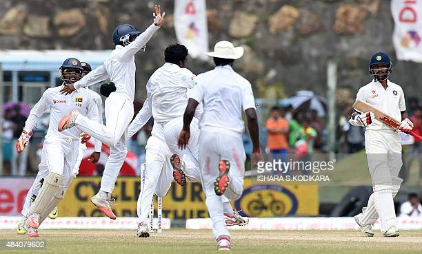 Sri Lankan cricketers celebrate after dismissing Indian batsman Shikhar Dhawan during the fourth day of the opening Test match between Sri Lanka and...