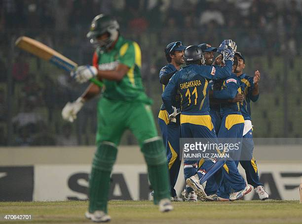 Sri Lankan cricketers celebrate after the dismissal of the Bangladesh batsman Shakib Al Hasan during the second OneDay International cricket match...