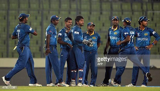 Sri Lankan cricketers celebrate after the dismissal of unseen Indian batsman Yuvraj Singh during the ICC World Twenty20 cricket tournament warmup...