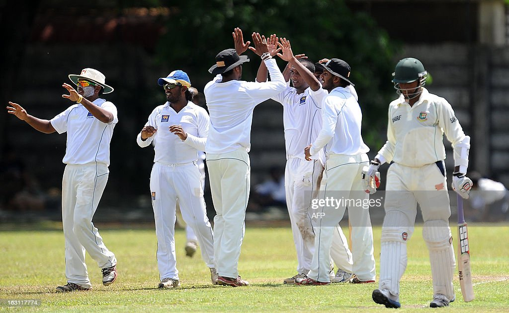 Sri Lankan cricketers celebrate the dismissal of Bangladesh cricketer Jahurul Islam (R) during the third day of a three day practice match between the Sri Lanka Development Emerging Team and Bangladesh at the Uyanwatte Stadium in Matara on March 5, 2013.