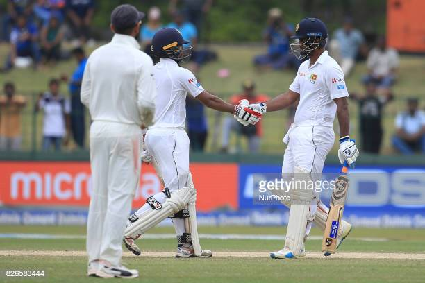 Sri Lankan cricketers Dimuth Karunaratne and Kusal Mendis congratulate each other during the 3rd Day's play in the 2nd Test match between Sri Lanka...