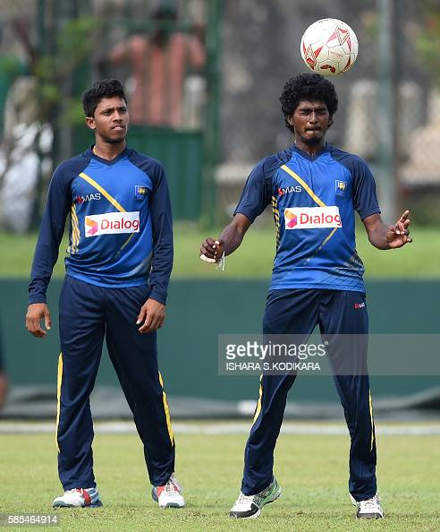 Sri Lankan cricketers Lakshan Sandakan and teammate Kusal Mendis play football during a practice session at The Galle International Cricket Stadium...