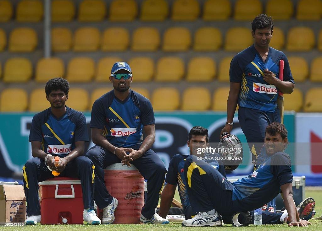 Sri Lankan cricketers Lakshan Sandakan Seekkuge Prasanna Lahiru Kumara Avishka Fernando and Suranga Lakmal look on during a practice session at the...