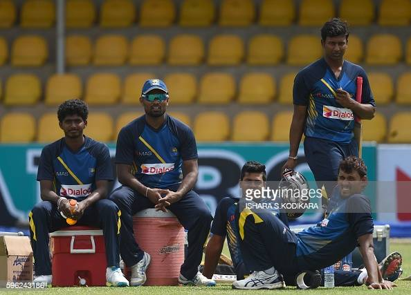 Sri Lankan cricketers Lakshan Sandakan Seekkuge Prasanna Lahiru Kumara Avishka Fernando and Suranga Lakmal look on during a practice session at the...