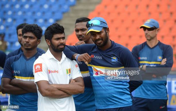 Sri Lankan cricketers react during the presentation ceremony after India's victory on the last day of the third and final Test match between Sri...