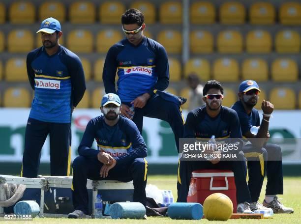 Sri Lankan cricketers Sachith Pathirana Niroshan Dickwella Milinda Siriwardana Kusal Mendis and Vikum Sanjaya look on during a practice session at...