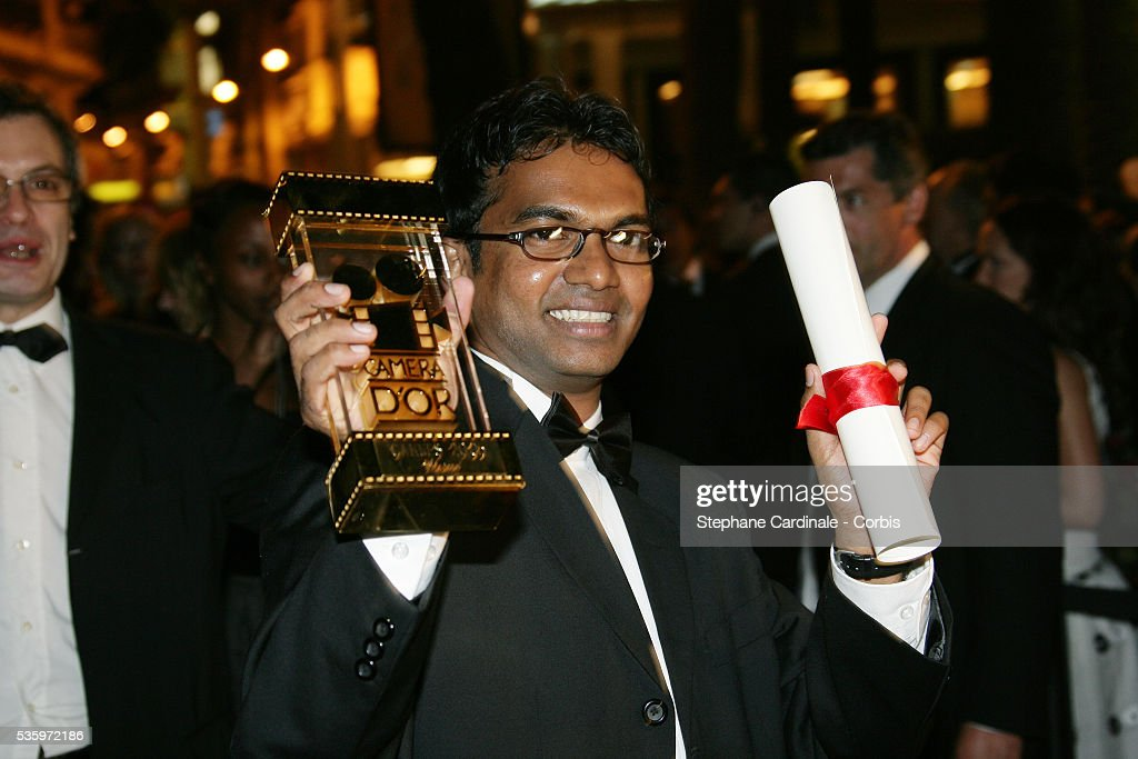 Sri Lankan director Vimukthi Jayasundara with his 'Camera d'Or' at the closing ceremony dinner during the 58th Cannes Film Festival.
