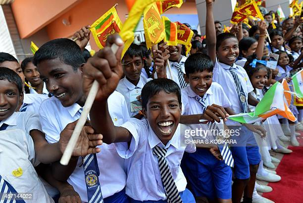 Sri lankan ethnic Tamil schoolchildren cheer as they welcome Sri Lankan President Mahinda Rajapakse to the rebuilt Jaffna railway station on October...